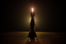 Single Burning Candle. Light Of Flame And Flowing Candle Wax, Dark Background