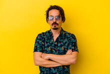 Young Caucasian Man Wearing Summer Clothes Isolated On Yellow Background Tired Of A Repetitive Task.
