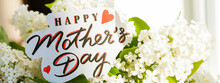 Lilac Flowers And Text Happy Mothers Day. Card With The Lettering Mother's Day, Greetings Card. Beautiful Bouquet With Spring Flowers.web Banner