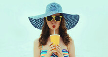 Woman Drinking A Juice Wearing A Straw Hat On A Beach On A Sea Background At Summer Day