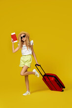 Girl With Red Suitcase And Passport With Ticket Going Traveling