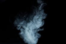 Abstract White Smoke Moves On Black Background. Beautiful Swirling Gray Smoke.