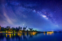 The Milky Way Galaxy, On Suanyai Bay Koh Mak Trat Provinc,Thailand.Long Exposure Photograph, With Grain.Image Contain Certain Grain Or Noise And Soft Focus.