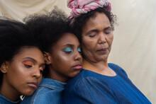Portrait Of Black Sisters Leaning On Aunt's Shoulder