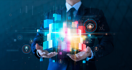 Businessman holding block chain network and cloud computing online connecting to big data innovation of technology. Analytics and intelligence data storage develop smart decision in global business