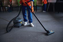Cleaning Lady Using A Canister Vacuum Cleaner