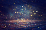Fototapeta Kawa jest smaczna - background of abstract glitter lights. gold, blue and black. de focused