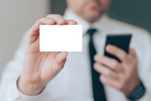 Businessman Showing Blank Business Card As Mockup Copy Space