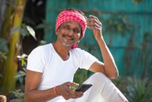 Indian Farmer Holding Mobile Phone