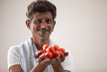 An Indian Farmer Holding Cherry Tomatoes