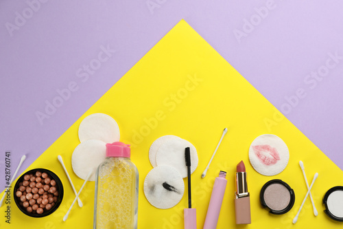 Obraz Dirty cotton pads, swabs, cosmetic products and micellar cleansing water on color background, flat lay - fototapety do salonu