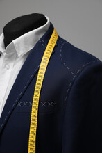 Semi-ready Jacket With Tailor's Measuring Tape On Mannequin, Closeup