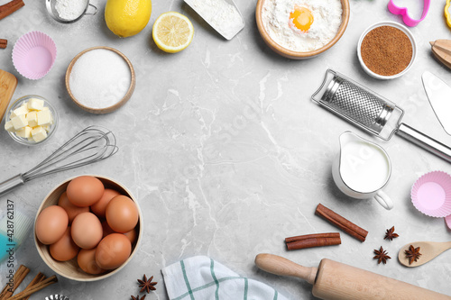 Obraz Frame of cooking utensils and ingredients on light marble table, flat lay. Space for text - fototapety do salonu