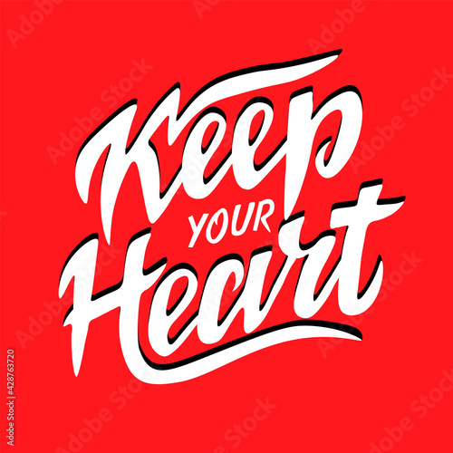 Fotografija Hand lettering wth Bible verse Keep your heart on red background