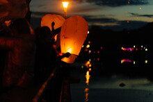 In The Evening, At Sunset, People With Their Relatives And Friends Launch Traditional Lanterns. Tradition And Travel