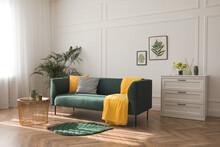 Stylish Living Room Interior With Comfortable Green Sofa