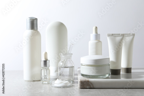 Obraz Organic cosmetic products and laboratory glassware on white table - fototapety do salonu