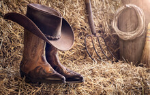 Country Music Festival Live Concert Or Rodeo With Cowboy Hat And Boots In Barn