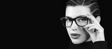 Monochrome Young Woman With Braided Hair Wearing Eyeglasses. Vision Care, Optometry And Fashion Eye Wear Concept Isolated On Black Background
