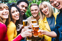 Happy Friends Toasting Beer At Brewery Bar Dehor - Friendship Life Style Concept With Young Millennial People Enjoying Time Together At Open Air Pub - Warm Vivid Filter With Focus On Central Guy