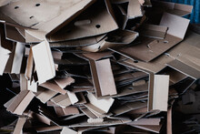 Close Up Of Heap Of Crumpled Cardboard Boxes On A Farm.