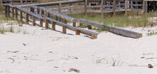 Boardwalk On The Beach Partially Covered By Encroaching Sand