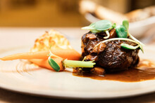 Grilled Angus Beef Tenderloin Steak With Honey Glazed Baby Carrots, Duchess Potatoes And Mushroom Jus