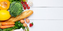 Vegetables, Fruits Assortment And Bottle Of Milk On White Wooden Background. Vegetarian Healthy Food Concept. Food And Grocery Shopping