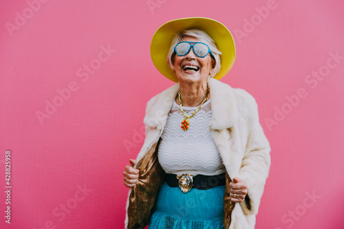 Canvas Print Happy grandmother posing on colored backgrounds