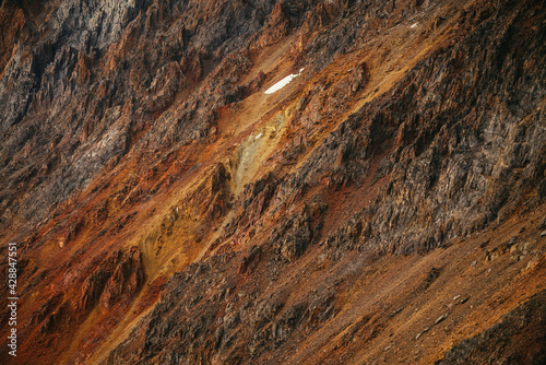 Scenic nature background of multicolor mountain. Colorful nature backdrop of motley rocks. Multicolor great rocks of vivid colors. Beautiful red orange rufous golden rocks. Closeup of motley mountain. - fototapety na wymiar