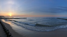Panoramic View Of Bright Sunset At Baltic Sea In Summer Day