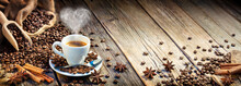 Coffee Espresso Cup With Beans And Cinnamon On Wooden Table
