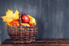 Harvest Or Thanksgiving Background With Autumn Fruits And Gourds On Rustic Wooden Table.