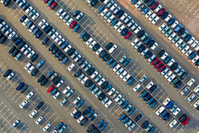 Aerial Top Down View Of The Dealership Or Customs Terminal Parking Lot With A Rows Of New Cars