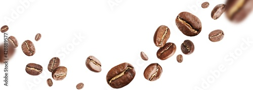 Fotografiet Dark aromatic roasts beans coffee levitate on white background with copyspace