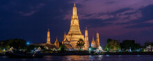 Banner Of Beautiful Night Scape View Of Wat Arun Ratchawararam Temple In Thailand. Landscape Picture Of Tourist Spot Landmark Of Bangkok At Night