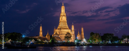 Banner of beautiful night scape view of Wat Arun Ratchawararam temple in Thailand. Landscape picture of tourist spot landmark of Bangkok at night - fototapety na wymiar