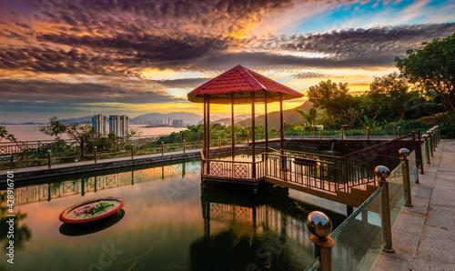 Fotografija Pavilion on the pond at sunset. Panorama