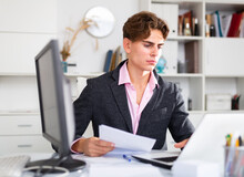 Adult Businessman Working In His White Office