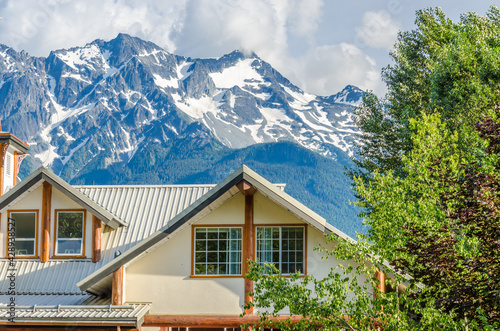 Luxury house over fantastic mountain view at sunny day in Vancouver, Canada. - fototapety na wymiar