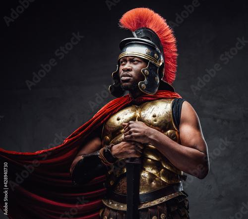 Fotografie, Obraz Proud roman warrior of african descent holding gladius