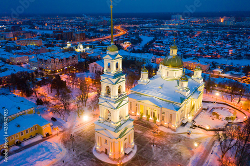 Scenic aerial view of snow covered cityscape of Penza overlooking restored architectural complex of Spassky Cathedral in winter evening, Russia. - fototapety na wymiar