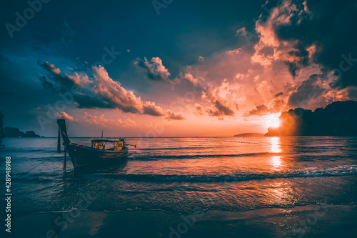 Fototapeta Amazing sunset with longtail boats silhouette at Railay beach, Thailand