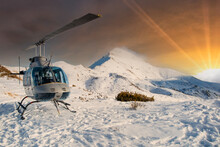 Helicopter In The Alps At Sunset