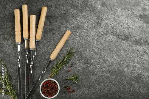 Obraz Flat lay composition with metal skewers on grey table. Space for text - fototapety do salonu