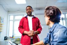 African American Student Having Class With Arabian Teacher Indoors