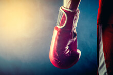 The Hand Of An Athlete In A Boxing Glove On A Dark Background.
