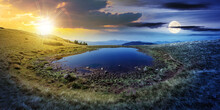 Day And Night Time Change Concept Above Pond On The Mountain Meadow. Wonderful Summer Landscape With Sun And Moon. Grass And Trees On The Hills. Ridge In The Distance. Beautiful Wide Panorama