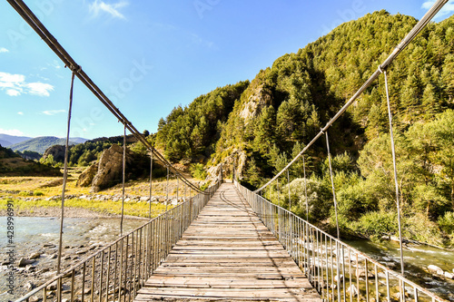 bridge over river, photo as a background , in janovas fiscal sobrarbe , huesca a Wallpaper Mural