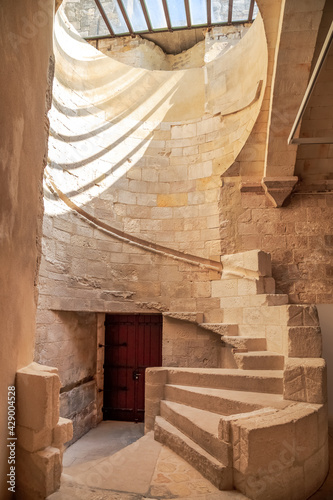 The spiral staircase leading to the bell tower inside the Montmajour Abbey near Arles, France, former medieval fortified monastery, now historical monument Fototapeta